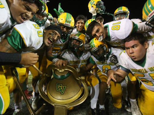 The Coachella Valley football team celebrates around the Victory Bell after beating Indio in the 2017 version of this rivalry.