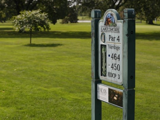 A sign indicates par for the first hole Sept. 15, 2017, at Lakeshore Municipal Golf Course in Oshkosh.