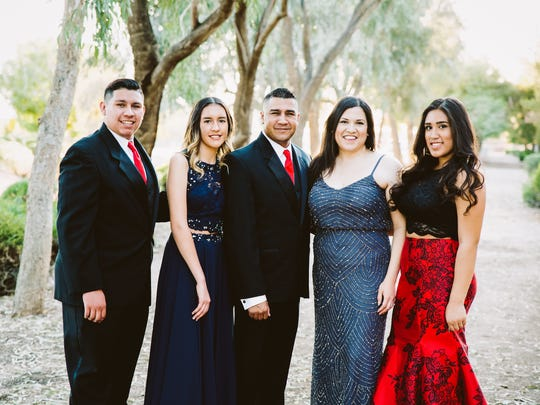 The Gonzales family pose together in March 2017 fro their daughter Lulu's Sweet 16. From the left: Elijah,18; Abby, 15; Adam, 42; Raquel, 36; and Lulu, 16.