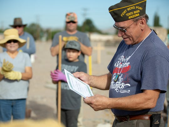 Stephen Elchlepp, with Tonto Basin Fort Reno VFW post 8807, receives a certificate of appreciation for making the 49 crosses that were installed at San Jose Cemetery with the help of the St. Genevieve Catholic Church Historical Society and Knights of Columbus on Monday, May 28, 2018.