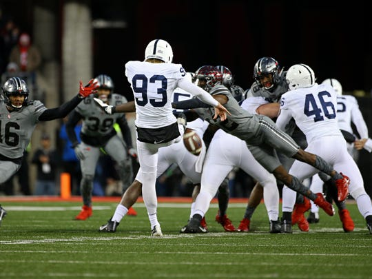 Penn State Nittany Lions punter Blake Gillikin (93) has his punt blocked by Ohio State Buckeyes cornerback Denzel Ward (12) in the second half at Ohio Stadium.