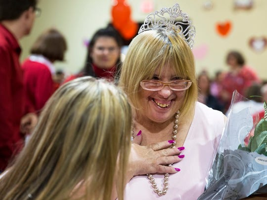 Stephanie Paris smiles in awe after being crowned queen during the 28th Annual Valentine's Dinner Dance at Emmanuel Lutheran Church in Naples, Florida on Friday, Feb. 10, 2017. Naples Civitan Club hosts the event for members of the Foundation for the Developmentally Disabled.