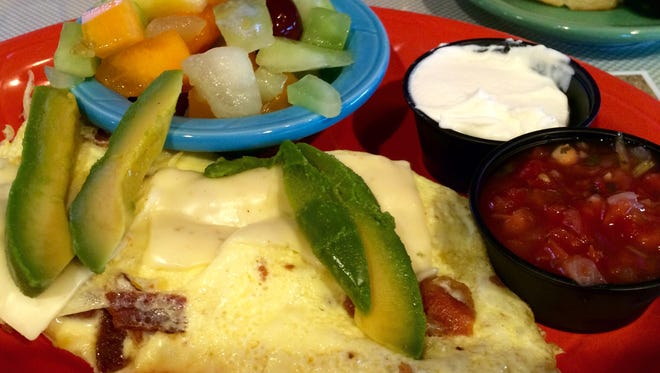 A bacon and avocado omelet from Mel's Diner in Fort Myers.
