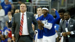 Kansas Jayhawks head coach Bill Self reacts during