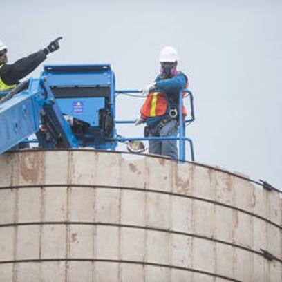 Crews begin work dismantling the centuries-year-old