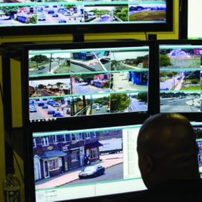 A Camden County police staffer observes surveillance