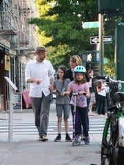 Daniel Friedman, Lora LaVon and their daughters, Binah, 11, left, and Thalia, 8, walking home in their Manhattan neighborhood.