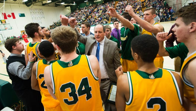Vermont head coach John Becker talks to his team during a timeout in the men's basketball game between the Stony Brook Seawolves and the Vermont Catamounts at Patrick Gym on Jan. 10.