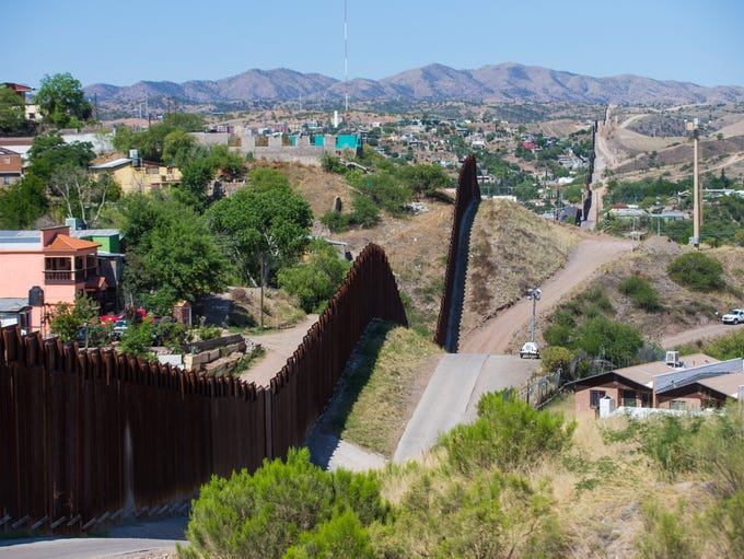 The vast border between the U.S. and Mexico (depicted here is Nogales) is the bridge for record heroin smuggling. Smugglers hide heroin everywhere - soda cans, secret car compartments, even baby strollers.