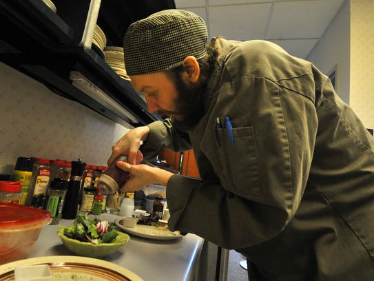 Chef John VanSlate prepares a bistro house salad Monday