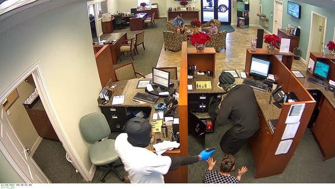 Port St. Lucie police release photos of suspects in a bank robbery at Seacoast Bank Dec. 28, 2017.