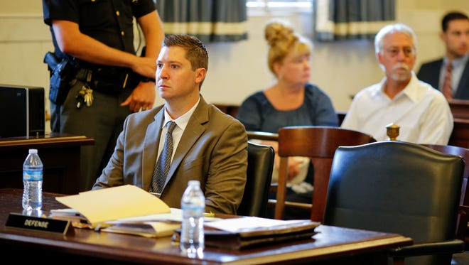 Former University of Cincinnati police officer Ray Tensing listens to arguments during a pretrial hearing, Friday, May 26, 2017, in Judge Leslie Ghiz's courtroom at the Hamilton County Courthouse in Cincinnati.