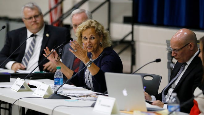 """The committee makes comments on their opinion during a meeting of the school board branding committee at Nagel Middle School in Anderson Township, Ohio, on Tuesday, June 12, 2018. The branding committee held a public meeting to discuss ending the use of the name """"Redskins""""."""