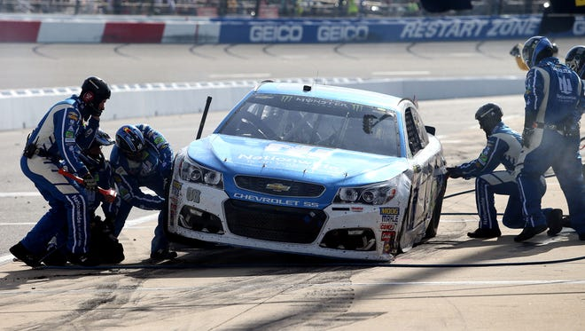 Dale Earnhardt Jr. hits pit road for adjustments during the Toyota Owners 400 at Richmond.