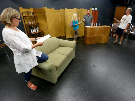 """Susan Coromel, left, and her fellow cast members prepare for Theatre 33's workshop of """"Successful Strategies, or How to Make Love Stay"""" at Willamette University."""