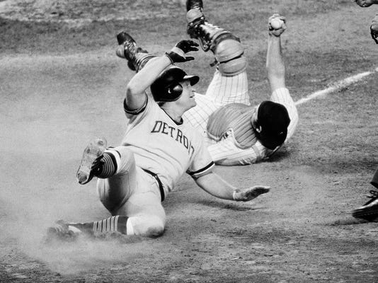 FILE - In this Sept. 5, 1978, file photo, Detroit Tigers' Rusty Staub looks towards the home plate umpire after being tagged out by New York Yankees catcher Thurman Munson on a sacrafice fly in the fourth inning of a baseball game in New York. Staub, who became a huge hit with baseball fans in two countries during an All-Star career that spanned 23 major league seasons, died Thursday, March 29, 2018, in Florida. He was 73. (AP Photo/G. Paul Burnett, File)