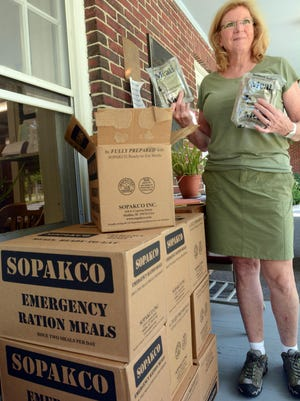 Pomfret first selectwoman Maureen Nicholson with emergency ration meals at Pomfret Town Hall Monday. [John Shishmanian/ NorwichBulletin.com\