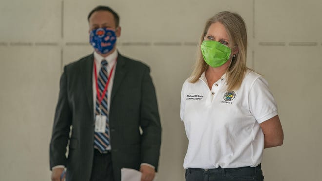 County Mayor Dave Kerner, left, and County Commissioner Melissa McKinlay at an April 27 news conference at the Palm Beach County Operations Center outside West Palm Beach.