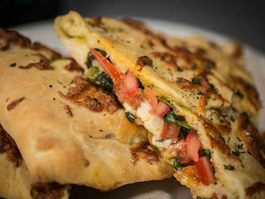 At the Jungle, a Margherita calzone stuffed with mozzarella, tomato and basil draws inspiration from a classic pizza Margherita.