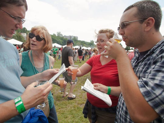 From left: Ben Sayles, Karen Sayles, Rachel LeBoeuf and Colton LeBoef choose their next beer stop.