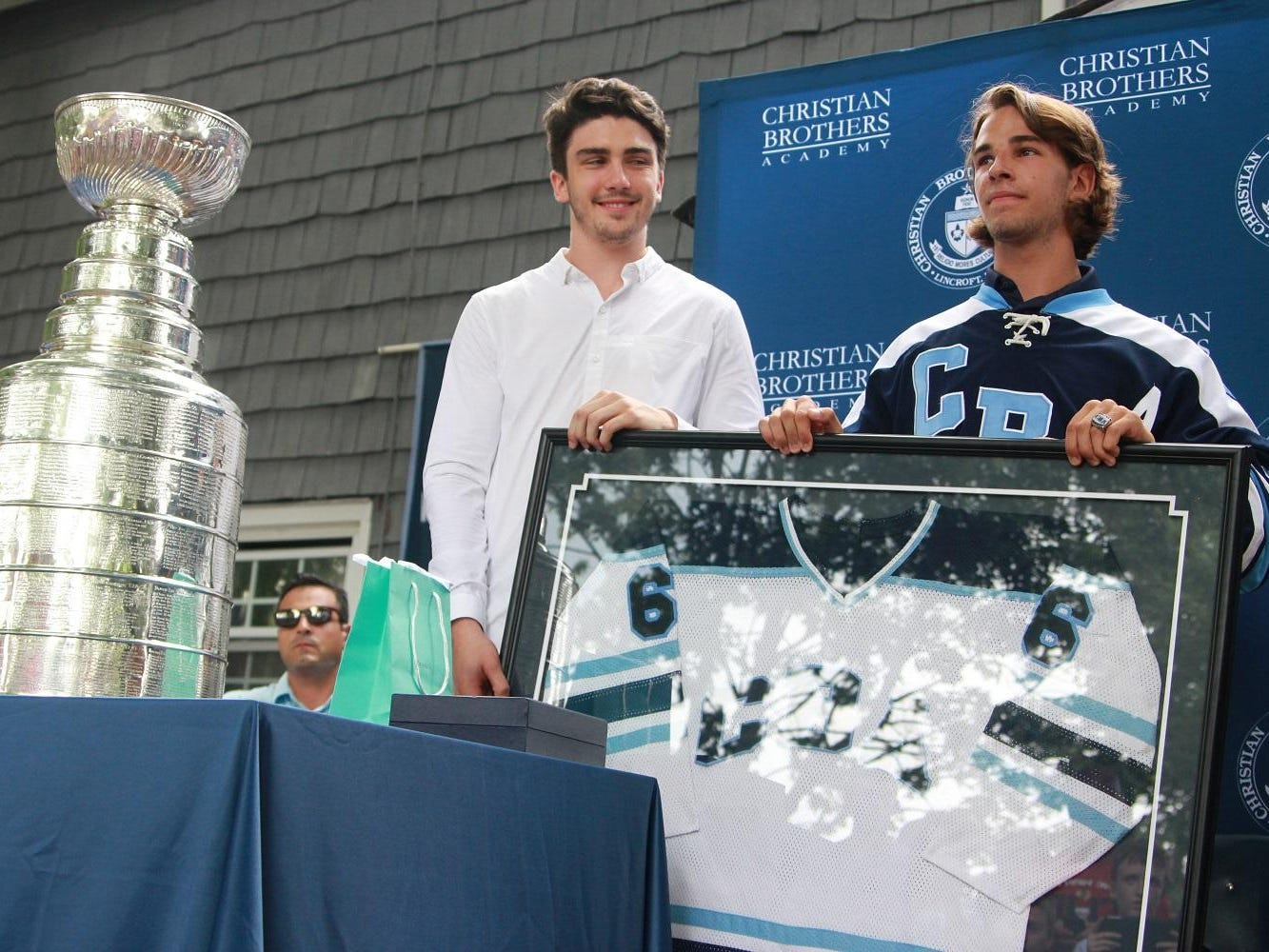 Trevor van Riemsdyk has his #6 jersey retired by CBA ice hockey at the Lincroft campus on July 30.