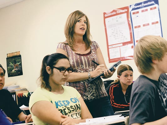 Laurel Dillard works on an algebra problem with her students on July 3 at Aztec High School.