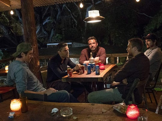 """Ben Affleck, left, Pedro Pascal, Charlie Hunnam, Oscar Isaac and Garrett Hedlund in """"Triple Frontier."""""""