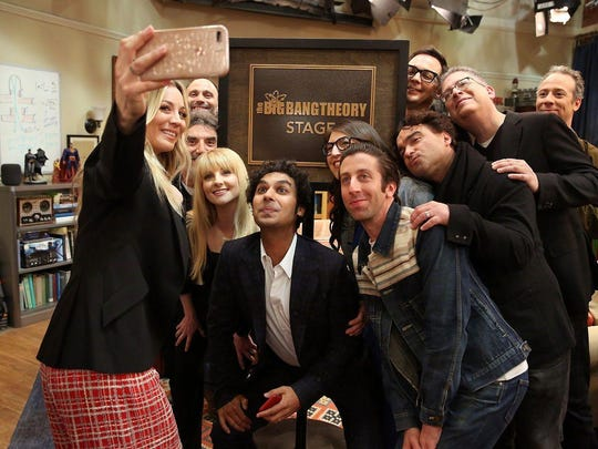 "Kaley Cuoco takes a group photo of ""The Big Bang Theory"" cast and producers after the soundstage was named for the series."