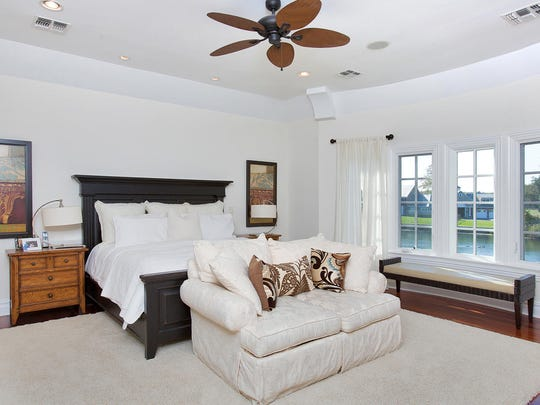 The Shore-inspired master bedroom features sweeping waterfront views.