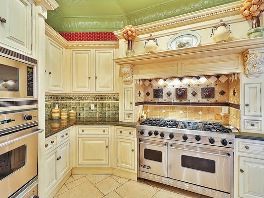 This kitchen, inspired by old-world Europe, contains many fine details, like a hand-laid tin ceiling.