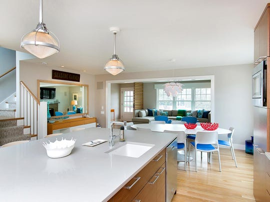"""This mid-century modern home is described as a """"cottage by the sea."""""""