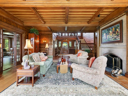 The living area inside 1 Allencrest Road in Rumson has a historic feel with beautiful woodwork.