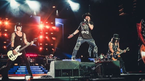 Guns N' Roses, featuring three of members from its classic lineup, Duff McKagan, left, Axl Rose, center, and Slash will perform Sept. 6 at Sun Bowl Stadium.