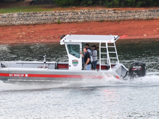 Oconee County dive team go to help emergency rescue workers and divers searching for a man who fell over a boat in Lake Hartwell Saturday afternoon.