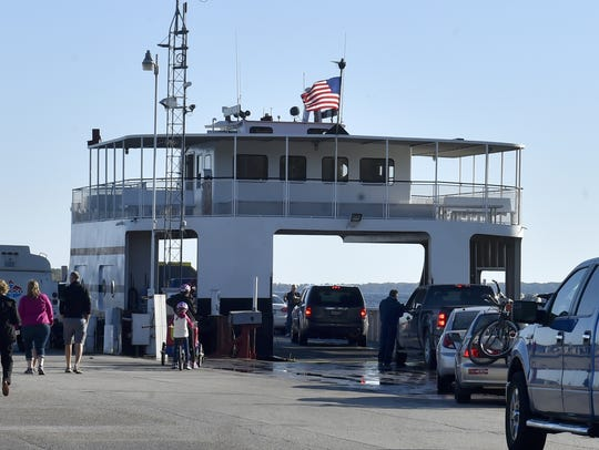 Passengers and vehicles board a Washington Island Ferry
