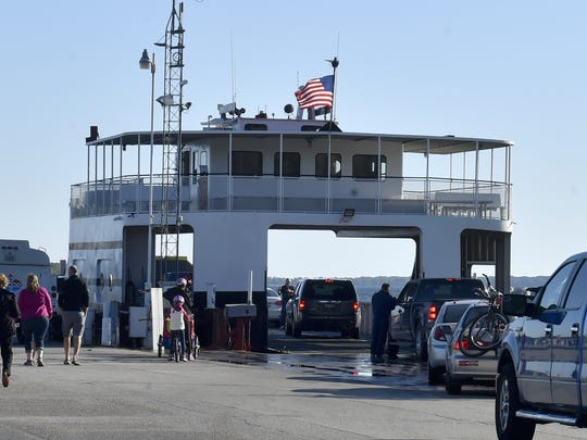 Passengers and vehicles board a Washington Island Ferry Line ferry at Northport on the northern tip of Door County's mainland enroute to Washington Island on Sunday, Oct. 8, 2017.