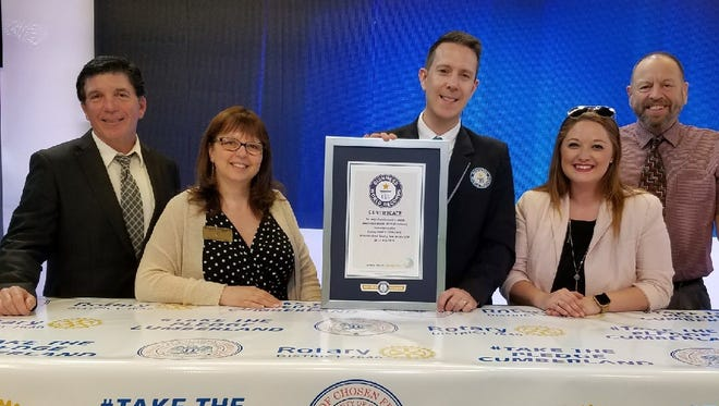 (From left) Jerry Covella, Melanie Druziako, Philip Robertson, Caitlin Nicke and Larry Malone stand with a Guinness Book of World Records certificate.