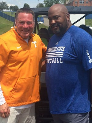 Tennessee football coach Butch Jones, left, and Tennessee State coach Rod Reed will team up for a satellite prospects camp at TSU in June.