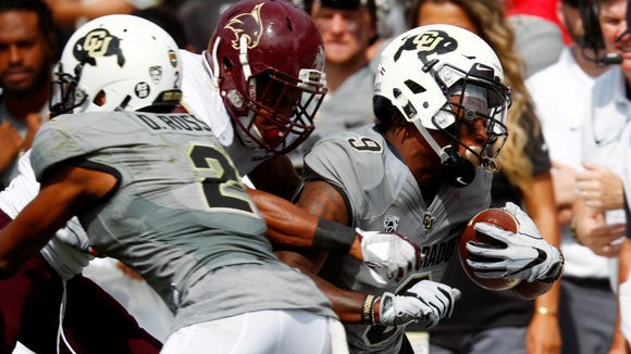 Colorado wide receiver Juwann Winfree, right, is pushed out of bounds after pulling in a pass in the second half Saturday, Sept. 9, 2017, in Boulder, Colo. Colorado won 37-3 over Texas State,