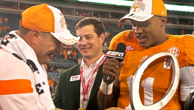 Tennessee Volunteers head coach Butch Jones admires the MVP trophy of quarterback Joshua Dobbs (11) after their 2015 TaxSlayer Bowl game against the Iowa Hawkeyes at EverBank Field. The Tennessee Volunteers beat the Iowa Hawkeyes 45-28.