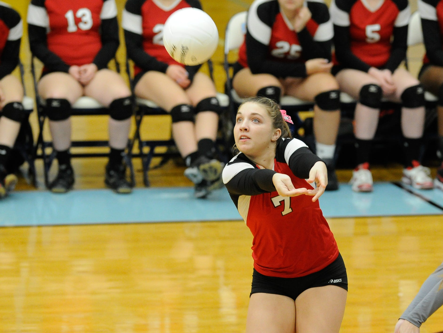 Conrad's #7 Anna Phillips setting the ball in the first game against Cape Thursday night at Cape Henlopen High School.