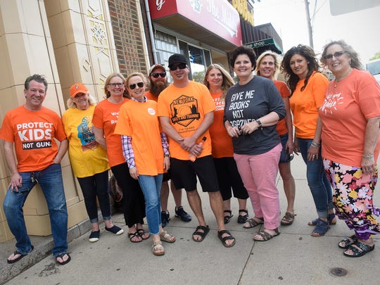 """Residents promoting an """"orange out"""" in St. Joseph to speak out against gun violence pose for a photograph on Minnesota Street Thursday, May 24."""