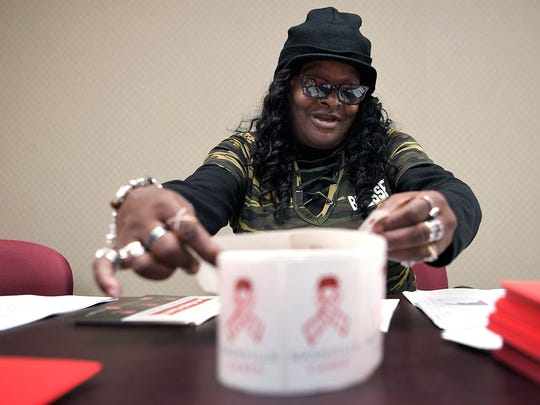 Margaret Williams, 63, volunteers at Nashville CARES in making volunteer packets on Tuesday, Dec. 5, 2017. Margaret came to Nashville CARES as a client. She was homeless, drug and alcohol addicted and HIV positive.   She's been clean and sober for 9 years now, and volunteers at Nashville CARES three days a week.