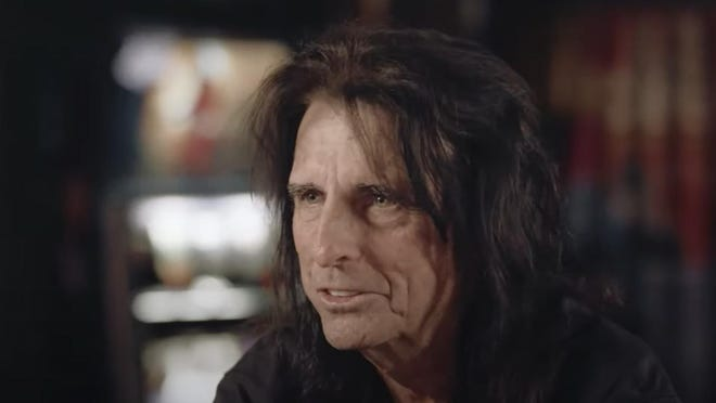 Rock star Alice Cooper was interviewed by California preacher Greg Laurie last year in Phoenix.