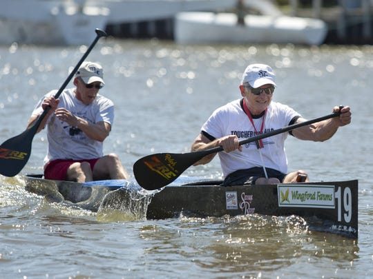 Teams race down the Black River during the 7th annual Back River Canoe race Saturday in Port Huron.