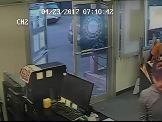 Two men are pictured on surveillance video at the Realm