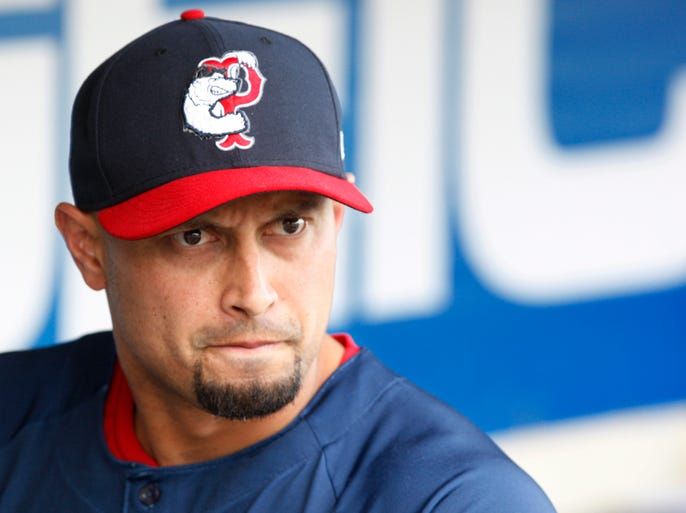 Pawtucket's Shane Victorino is all business when he gets into the dugout before the game June 16, 2014, in Rochester.