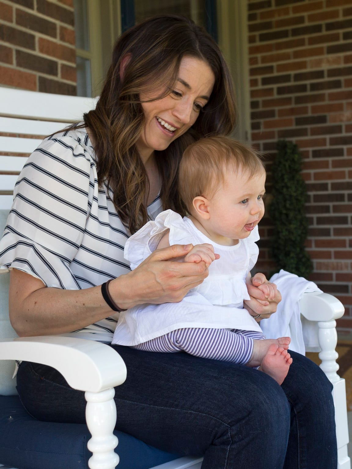 Brynn Guster holds her 7-month-old daughter, Amelia