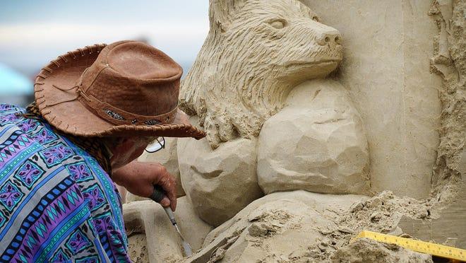 Justin Gordon, of Groveland, Massachusetts, begins his final sculpture at Hampton Beach Thursday for the 2020 Master Sand Sculpting Competition.