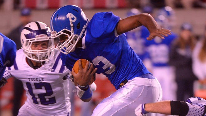 Dixie's Tre Miller ran for 101 yards and two touchdowns in a 45-6 win over Tooele in the 3AA semifinal game in 2015.